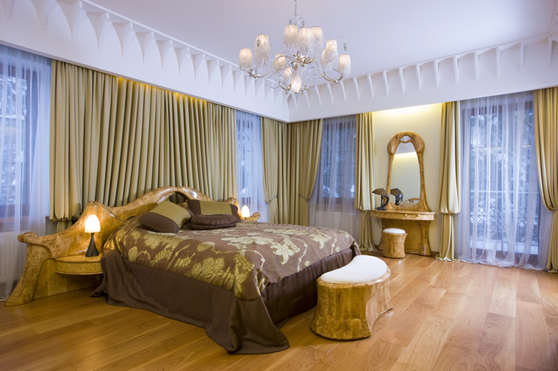 Contemporary luxury bedroom gold drapes