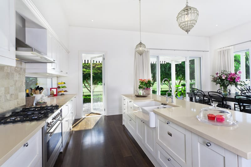 kitchen with white shaker style cabinets white quartz counter and dark hardwood floors: beautiful white kitchen cabinets
