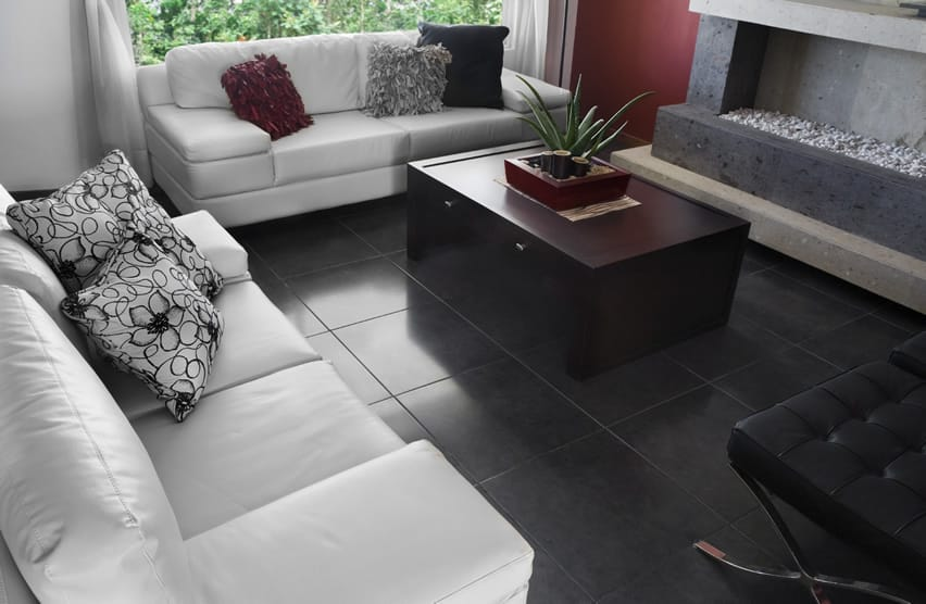 Living room with black tile and white furniture with an indoor fire pit