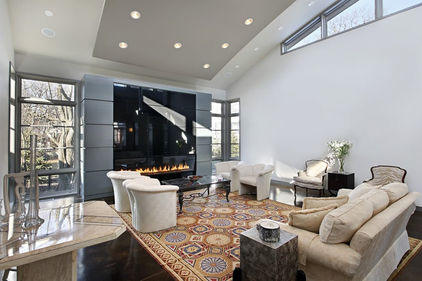 Living room with large glass fireplace and modern style. 67 Luxury Living Room Design Ideas   Designing Idea