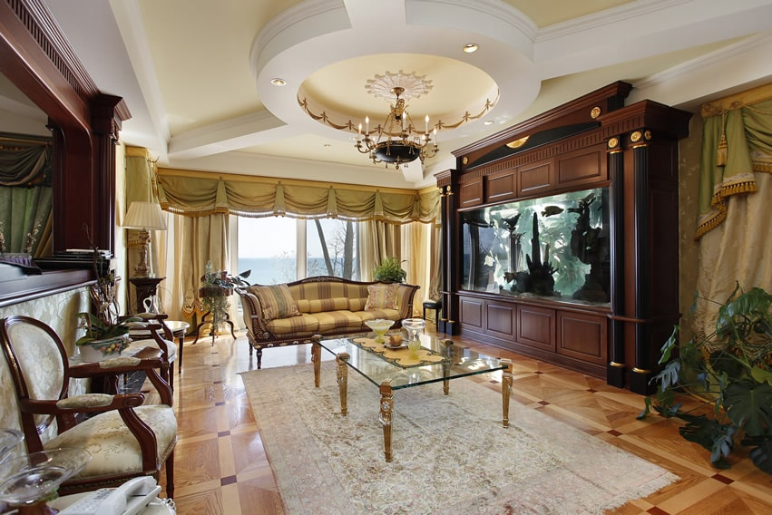 Luxury family room with large fish tank and elegant decor