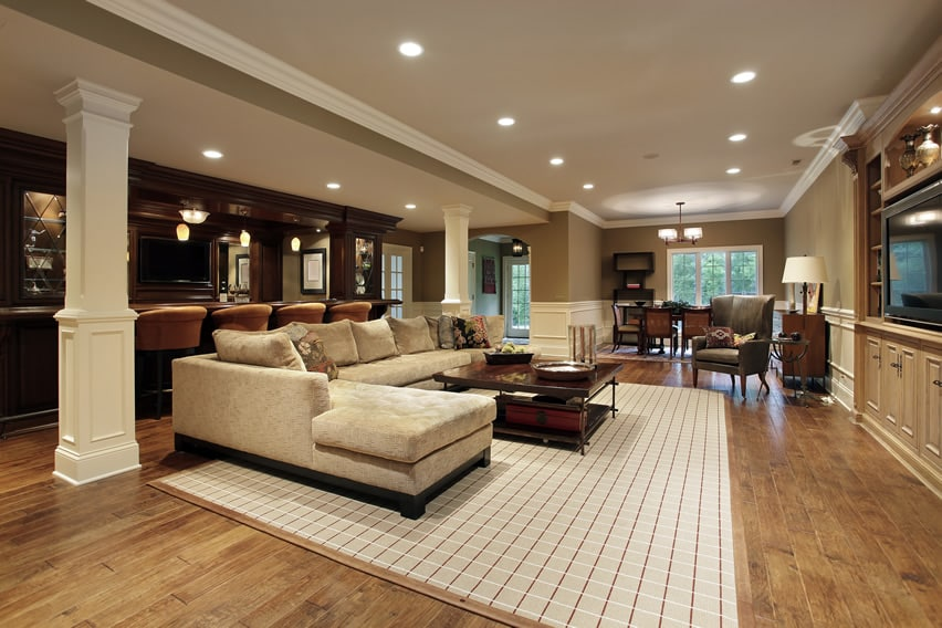 Luxury living room with wood bar and entertainment center