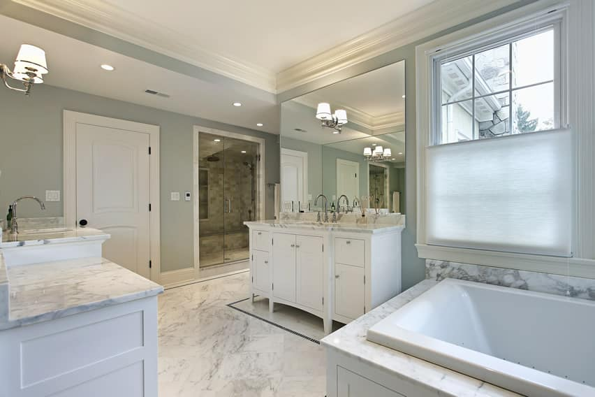 Luxury master bathroom in white marble