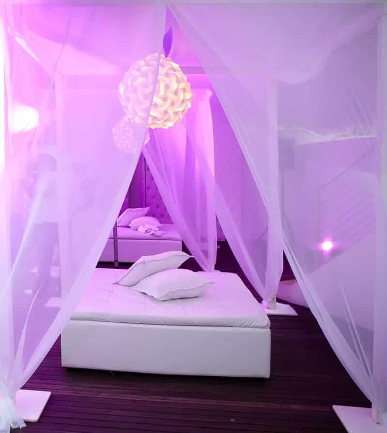 Luxury seating area in purple bedroom