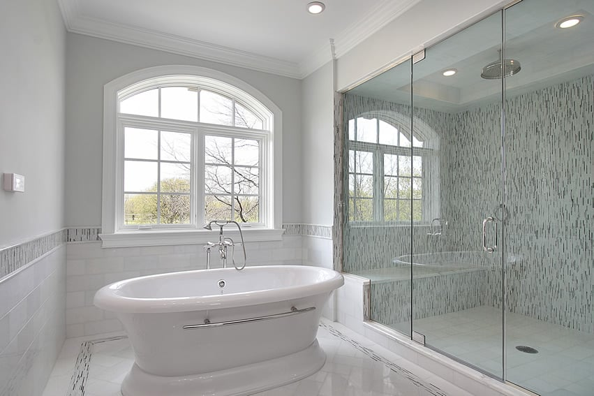 White design master bath with oversized shower and sitting bench