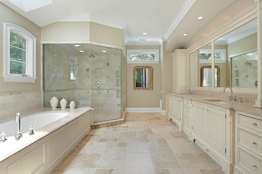Master bathroom with large glass shower dual sinks in white theme