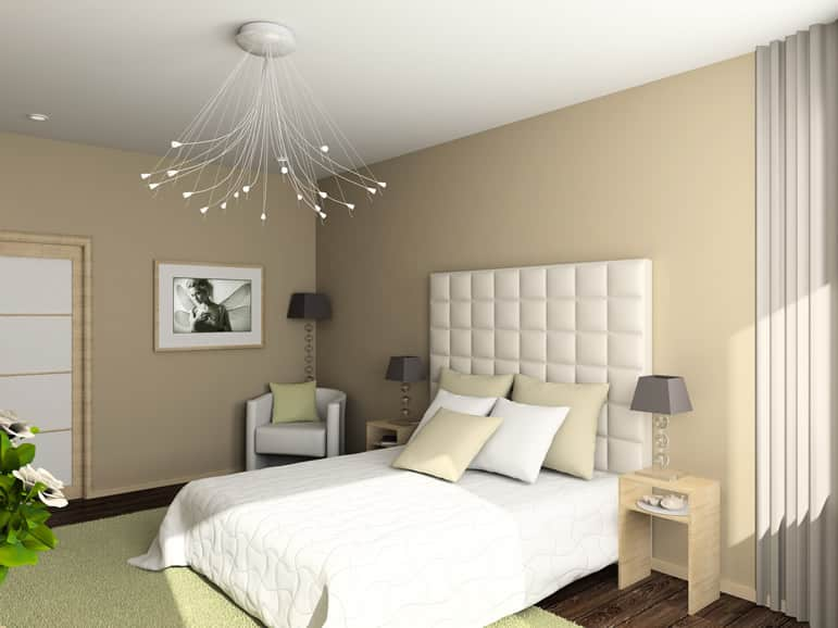 Modern bedroom with white bedboard hanging light