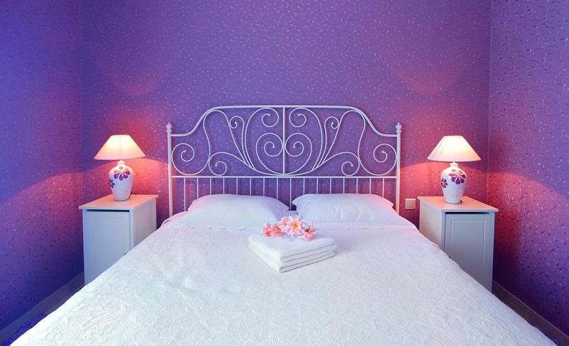 Pretty purple bedroom with decorative headboard