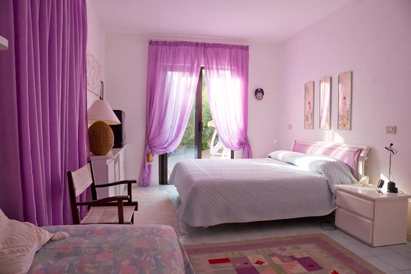 purple color room with matching drapes rug