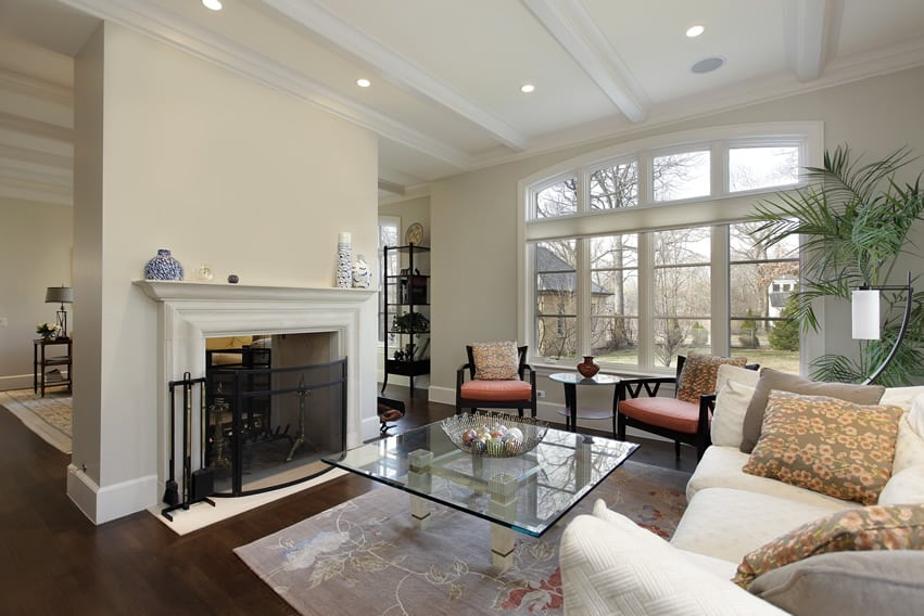 tastefully decorated living room with white fireplace