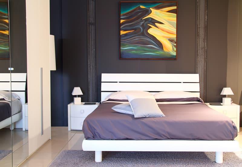 Trendy bedroom black wall purple bed covering