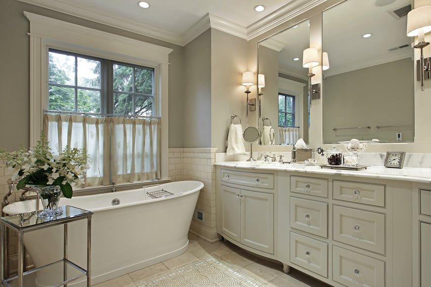 White bath with matching cabinets and marble counter