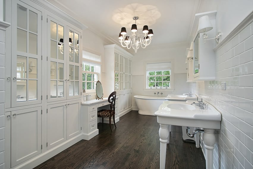 White master bathroom with white cabinets and makeup area