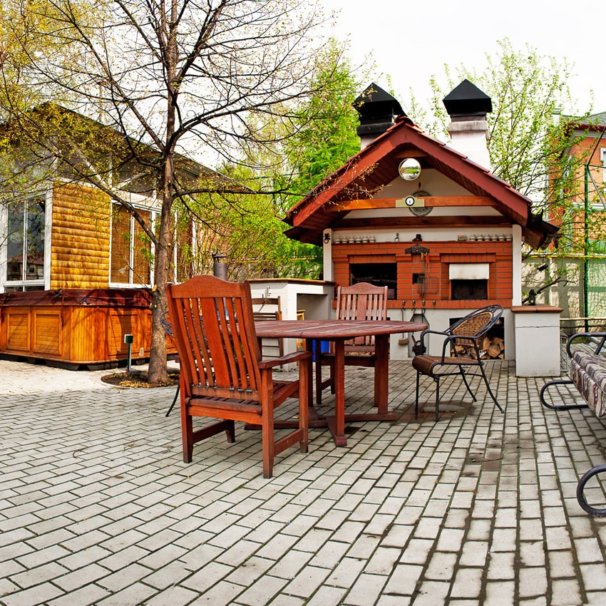 Large open barbecue patio area with brick oven/fireplace