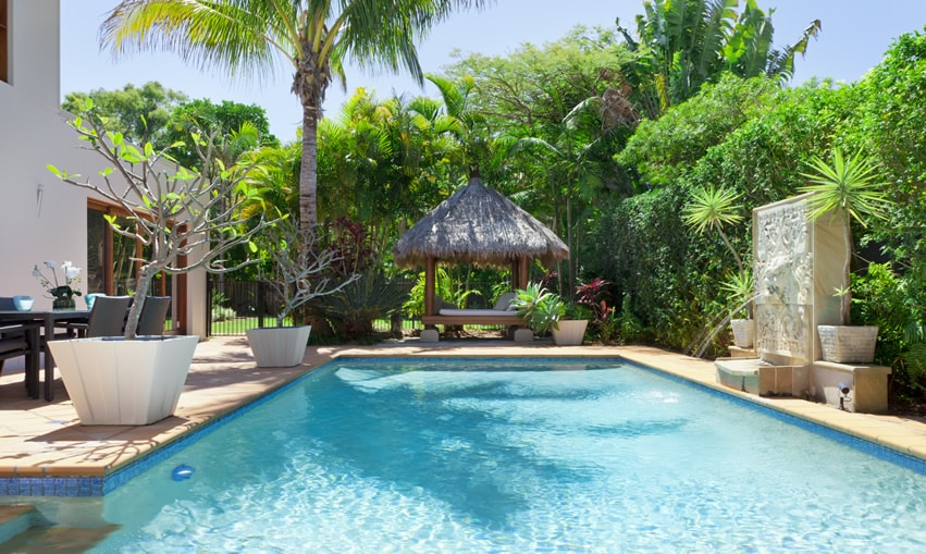 Backyard swimming pool at tropical home