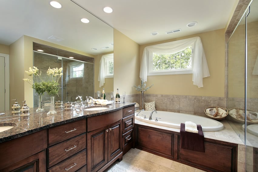 Master bathroom with Baltic brown granite countertop and Maple wood cabinets