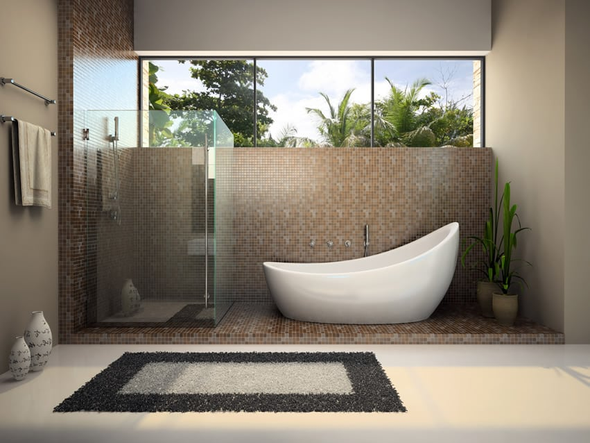 bathroom design with large plain white porcelain tiles and sloped bath