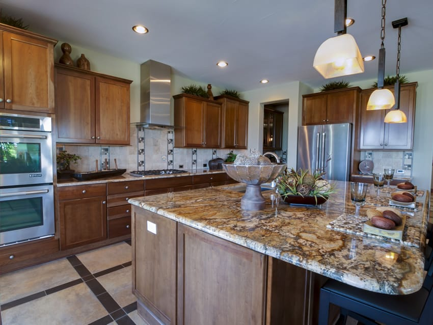 Beautiful designer kitchen with natural wood cabinets and large breakfast bar island with granite counter