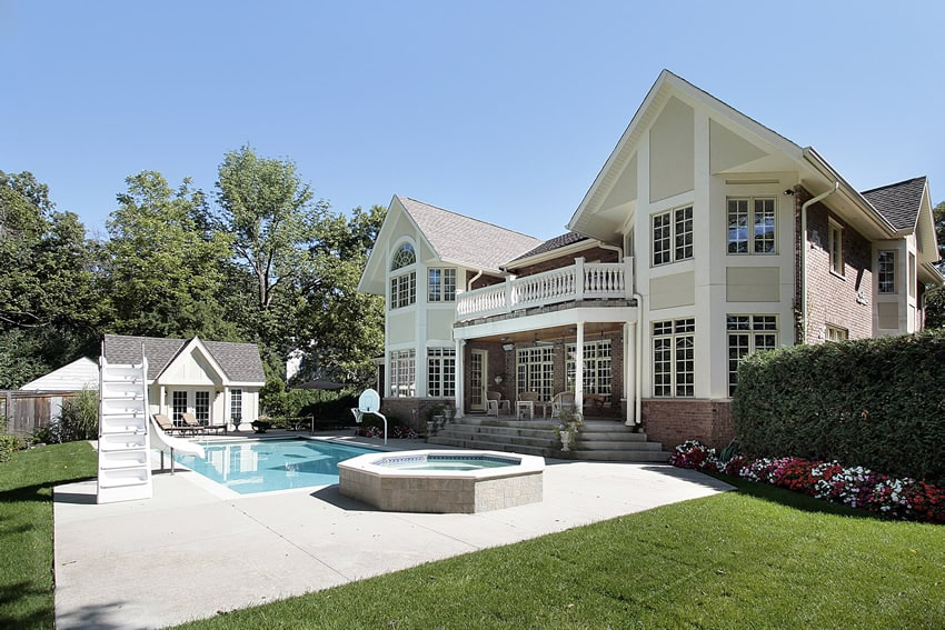 Beautiful home with swimming pool with slide and basketball hoop