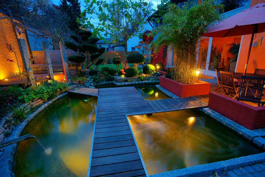 Beautiful lighted water feature with deck
