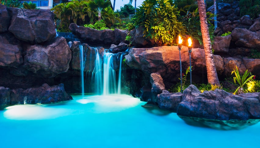 Beautiful lagoon swimming pool with rock waterfall