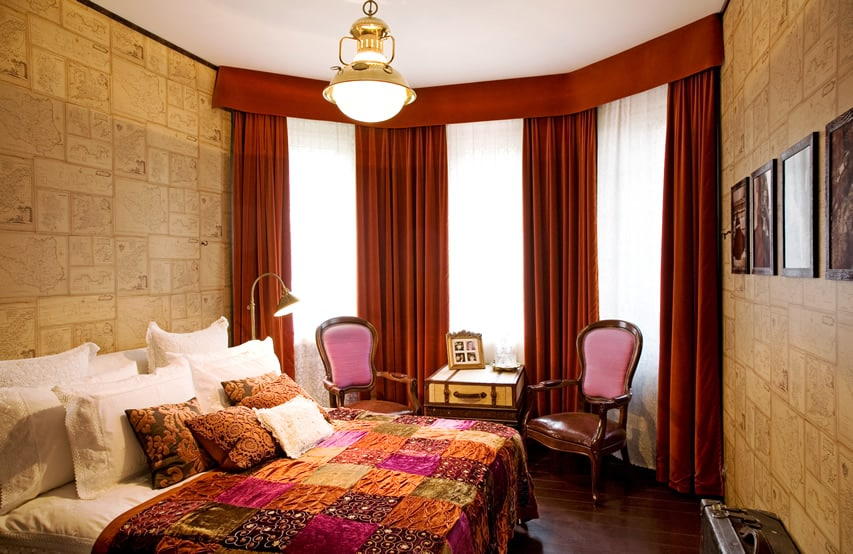 Bedroom with large curtained windows