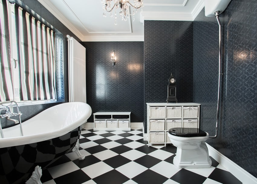 Black & white bathroom with Victoria double slipper claw foot bath tub