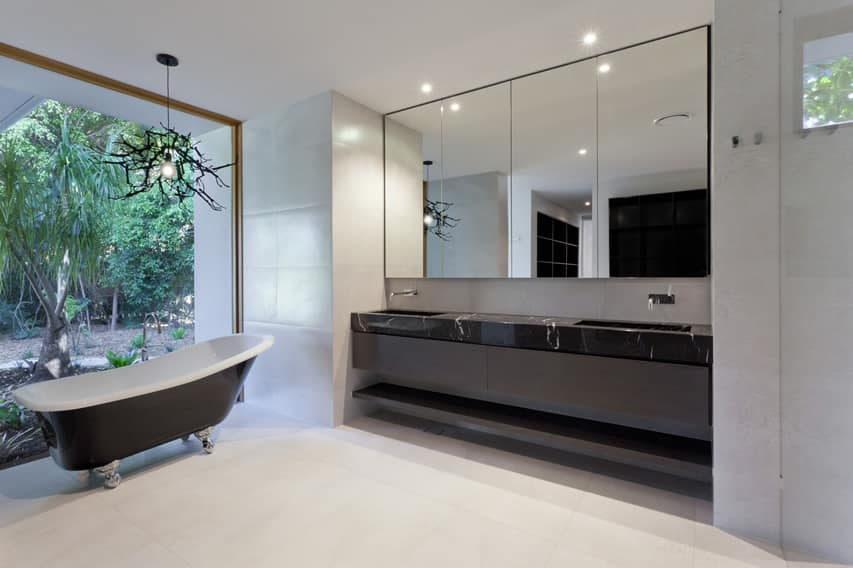Spacious bathroom with natural light and beautiful view of garden area