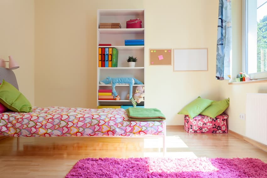 Funky colorful girl's room with yellow painted walls