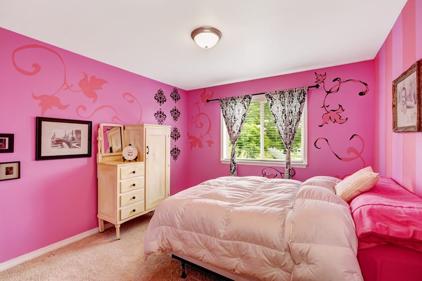 Hot pink girl's bedroom with soft beige carpets and bedding with flower wall stencils