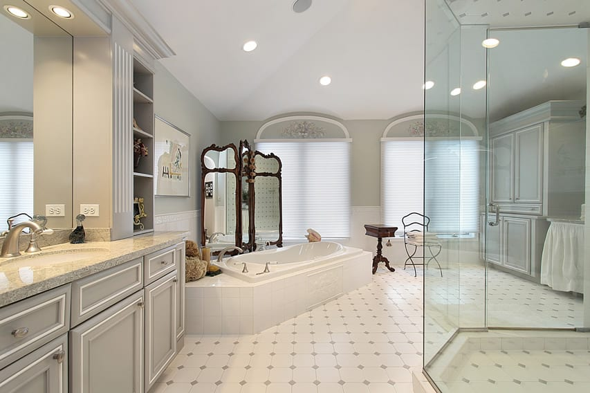 Large bathroom uses light finishes with white ceramic tiles and light gray diamond details