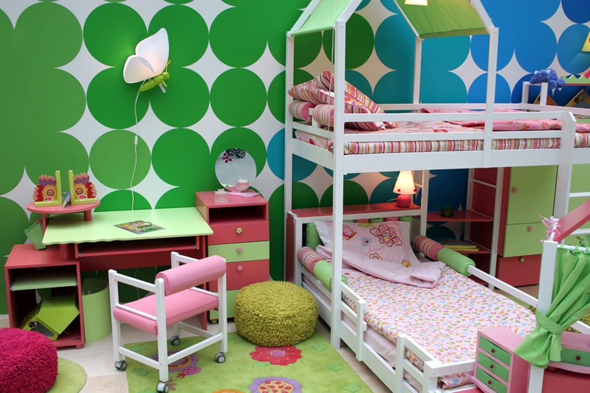 Vibrant girl's room with white bunk beds and cute kids desk