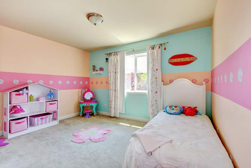 Pastel girl's bedroom with storage cubby
