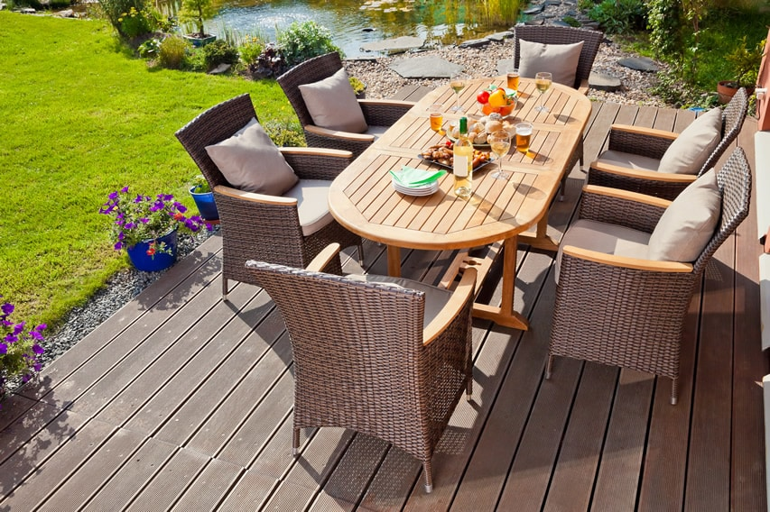 Composite deck and outdoor dining area with pond view