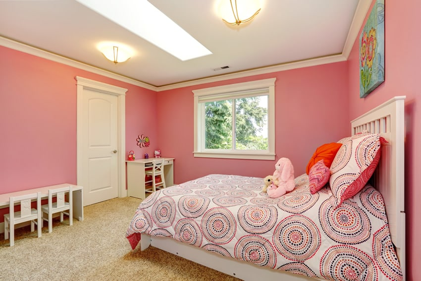 Pretty girl's bedroom with small desk, table and chairs