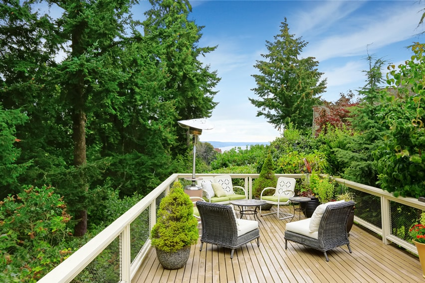 Deck with sitting area and view or trees