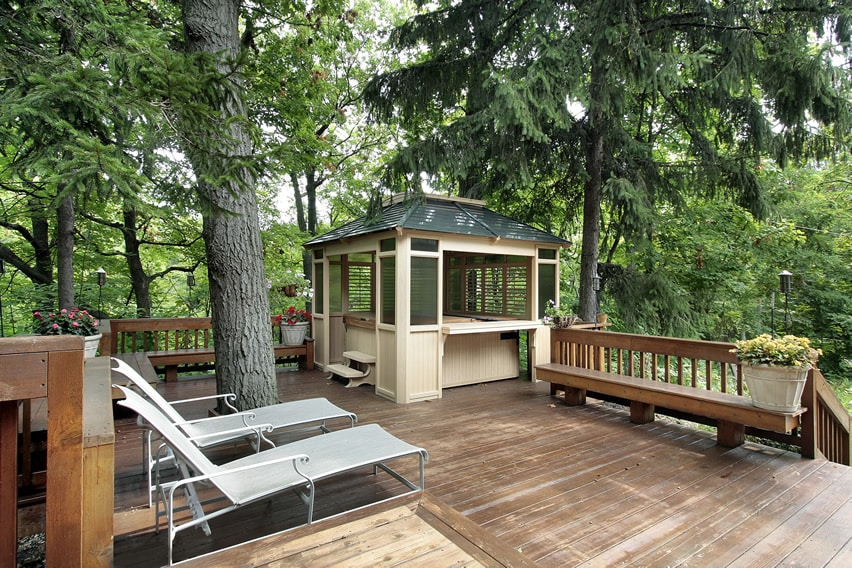 Deck with tree view a gazebo and hot tub area