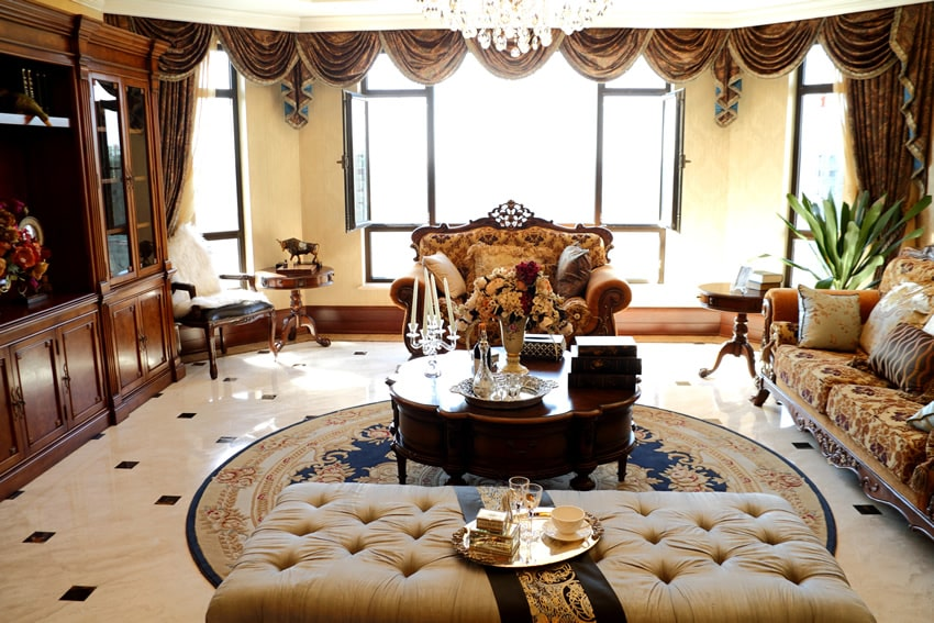 Elegant classic living room with wood furniture and draping curtains