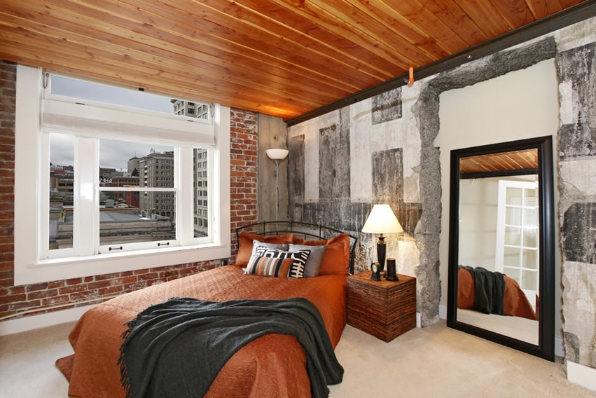 Exposed brick concrete walls modern bedroom