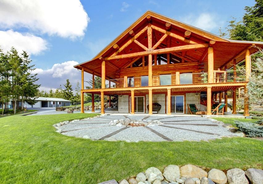 Firepit behind log cabin