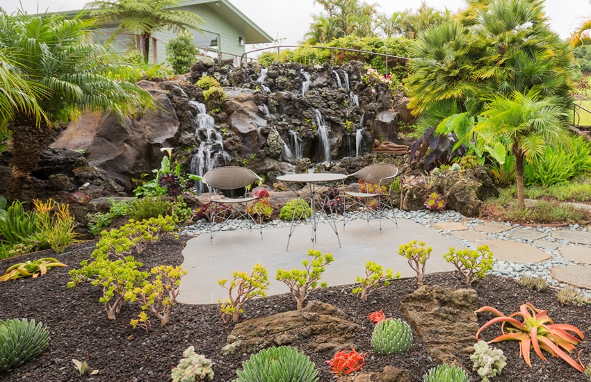 Garden patio with rock waterfall