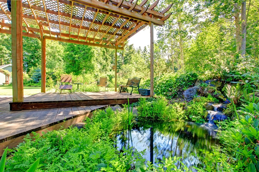 Garden pergola with waterfall and pond