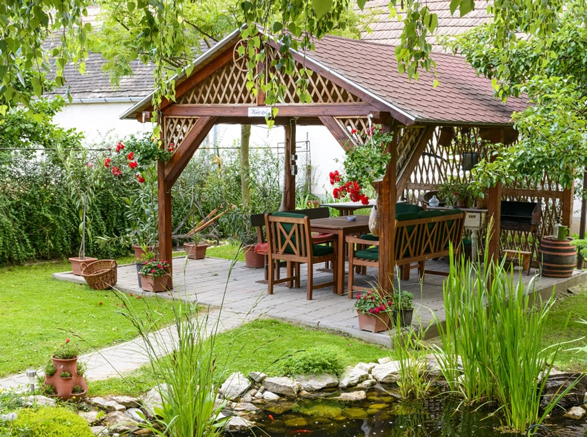Gazebo with outdoor dining area and patio
