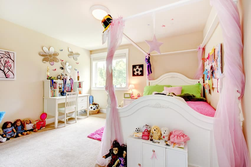 Girl's bedroom with cotton candy pink lace canopy curtains