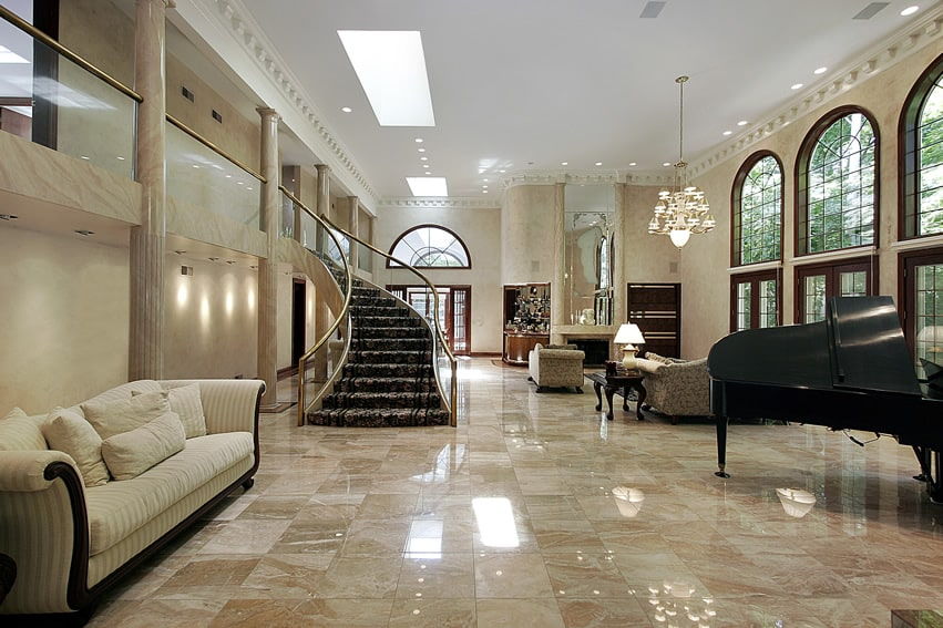 Huge living room with balcony, marble floors and grand piano
