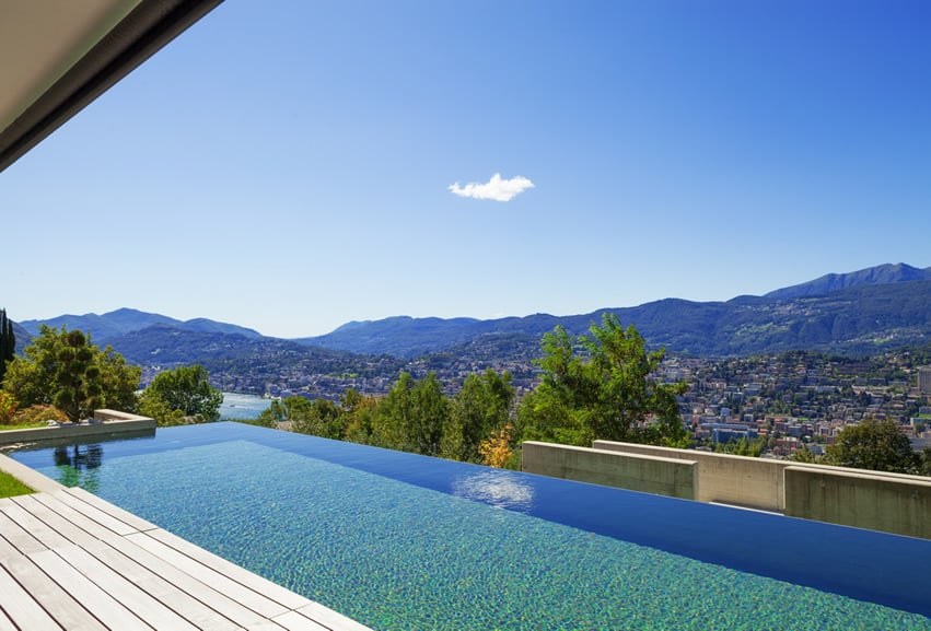 Infinity pool with view of town and mountains