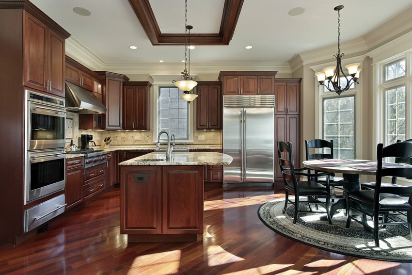 Kitchen With Red Mahogany Cabinets Light Color Granite And Dining Nook
