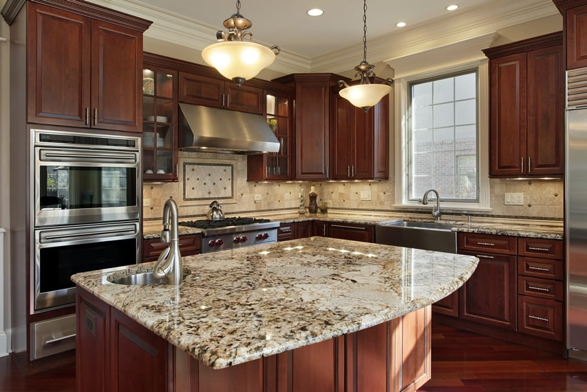 Kitchen with mahogany cabinets and St. Cecilia granite island in new home  design