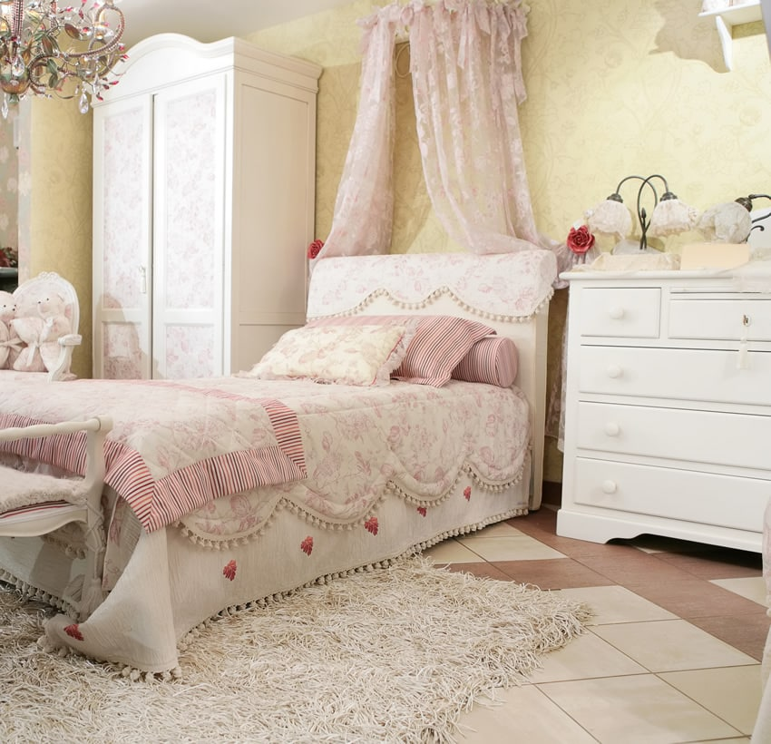 Sweet traditional girl's bedroom with canopy and elegant furnishings