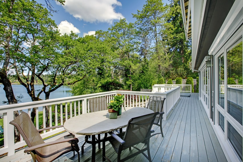 Lake view wood deck with white railings